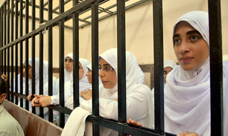 Egyptian women in Alexandria prison cage while being sentenced to 11 years for protesting military rule. The opposition to the generals is increasing. by Pan-African News Wire File Photos