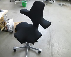 automotive exterior(0.0), armrest(0.0), sitting(0.0), furniture(1.0), office chair(1.0), table(1.0), chair(1.0),