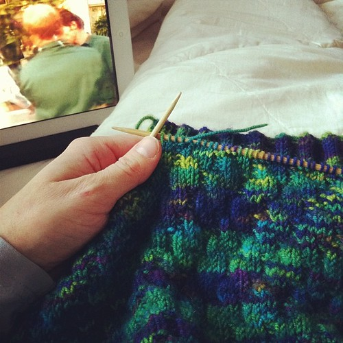 On the couch: working on a knitting project started ages ago while watching what appears to be a cheesy 80's netflix movie #cozyindoors #notgoingoutside