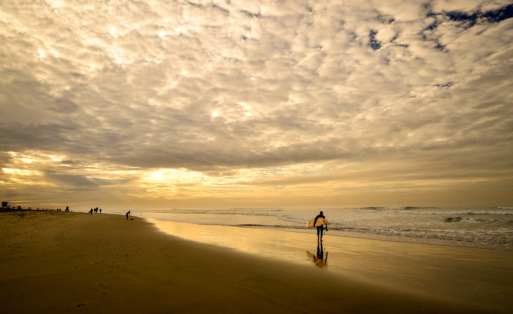1 of (2) Surf's Up at sunrise in Huntington Beach, California