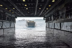 A landing craft utility (LCU) with U.S. Marine Corps equipment aboard enters the well deck of USS Denver (LPD 9), Feb. 5.