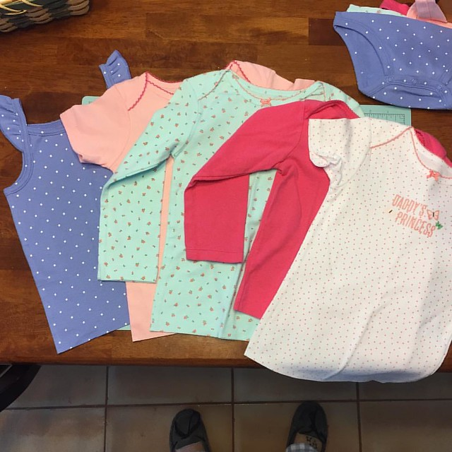 I just turned a handful of 24 month onesies into shirts for Peyton! They weren't going to be used since she's potty trained and now I don't have to scour the clearance racks for shirts in her size! I'm still debating if I should hem the bottom of the shir