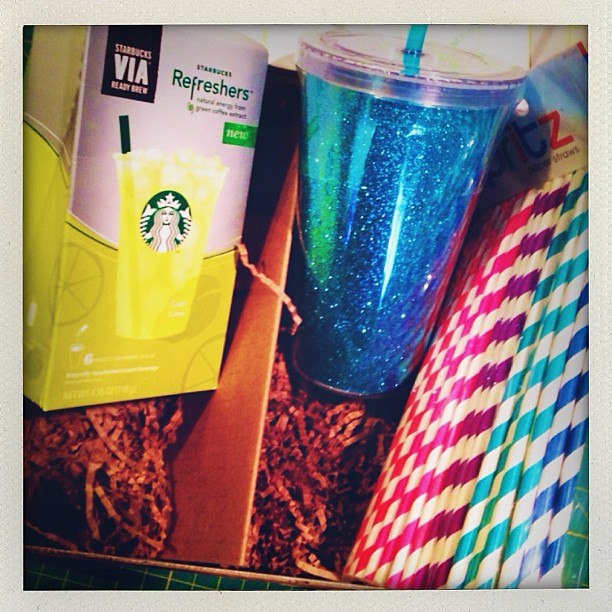 "Super fun package that I received from @teganaubrie for @cuppakim Annual Mug Swap! Love the sparkly ""mug"", super cute straws, and Starbucks drink pouches! #mugswap2013"