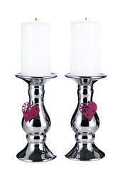 decor(0.0), light fixture(0.0), glass(0.0), lighting(0.0), candle(1.0), candle holder(1.0),
