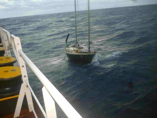 The motor vessel Athina L responded to a Coast Guard Automated Mutual-Assistant Vessel Rescue System request and rescued the sole person onboard the disabled sailing vessel Easy Go on November 3, 2013.