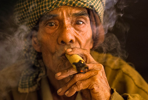 Satisfaction.  Cherub Smoker, Burma.