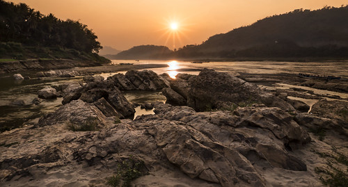 travel light sunset sky orange water river landscape stones laos mekong luangprabang