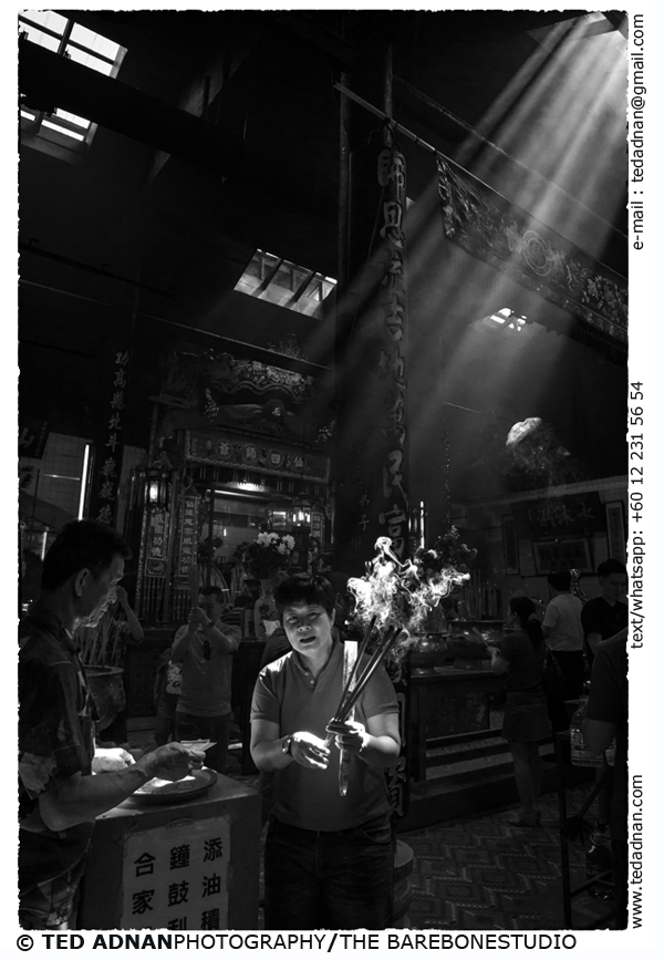 A visitor lights up jossticks at Sze Ya Temple, amongst the oldest Taoist temple in Kuala Lumpur Malaysia during Chinese Lunar New Year 2014.