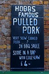 commemorative plaque(0.0), street sign(0.0), poster(0.0), signage(1.0), sign(1.0), number(1.0), font(1.0), blackboard(1.0), advertising(1.0),