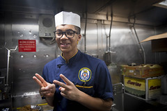 170309-N-DZ075-0011 PHILIPPINE SEA (March 9, 2017) Culinary Specialist Seaman Kirk Aaron Briscoe Jr., a Baltimore native assigned to the Arleigh Burke-class guided-missile destroyer USS Stethem (DDG 63), poses for a photo on the messdecks. Stethem is on p