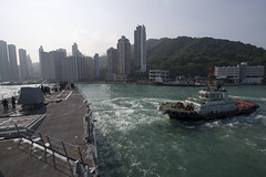 A harbor tug assists USS Sterett (DDG 104) upon arrival in Hong Kong, April 29. (U.S. Navy/MC1 Byron C. Linder)
