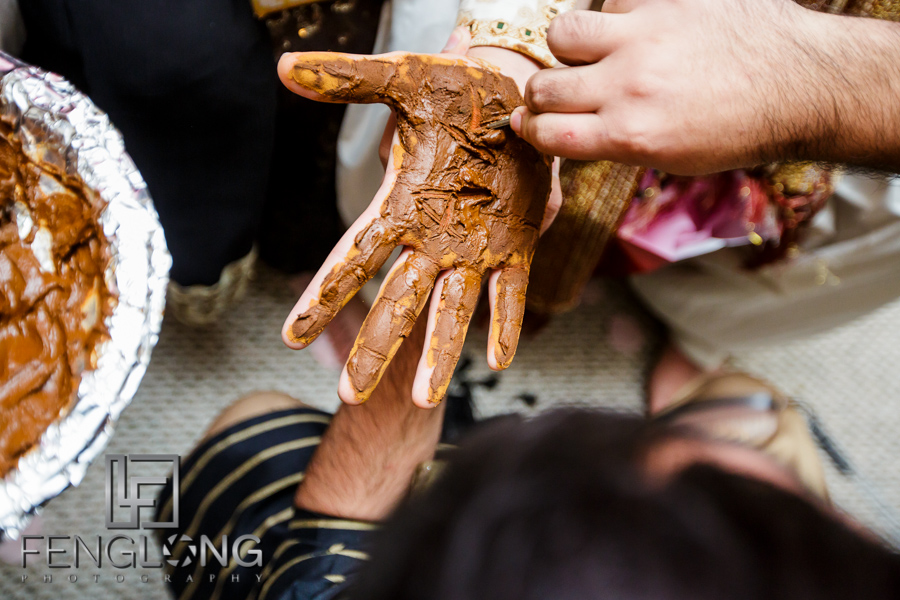 Groom's hands with henna applied during Ismaili wedding