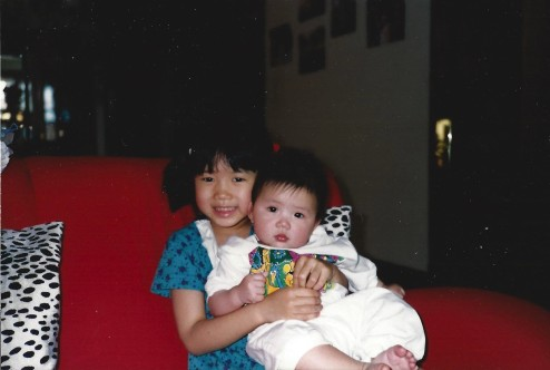 The author as a child holding her sister