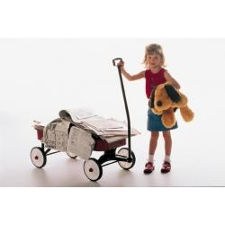 Little girl with red wagon