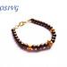 Pulsera perlas color bronce y accesorios dorados