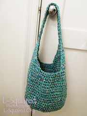 Completed shopping bag hanging from a door knob