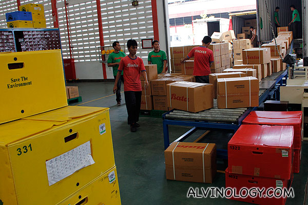 Loading of the boxes of shoes for transportation to local stores or for export