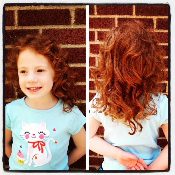 She had her first haircut ever today.  A few inches shorter and it's a lot curlier! #redhead #picstitch