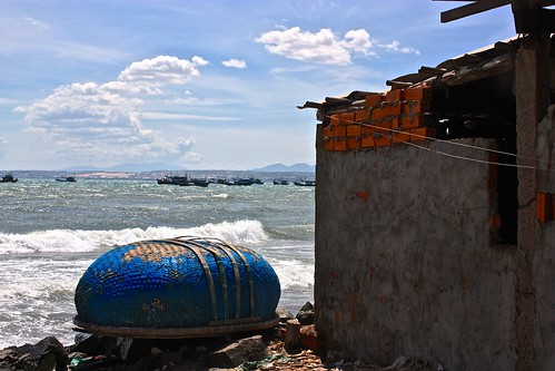 View of the harbor from the vantage point of a flipped fishing boat. Yes, locals use these basket-like things as boats