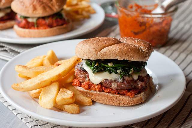 Sausage Burgers with Garlicky Spinach and Sun-dried Tomato Pesto