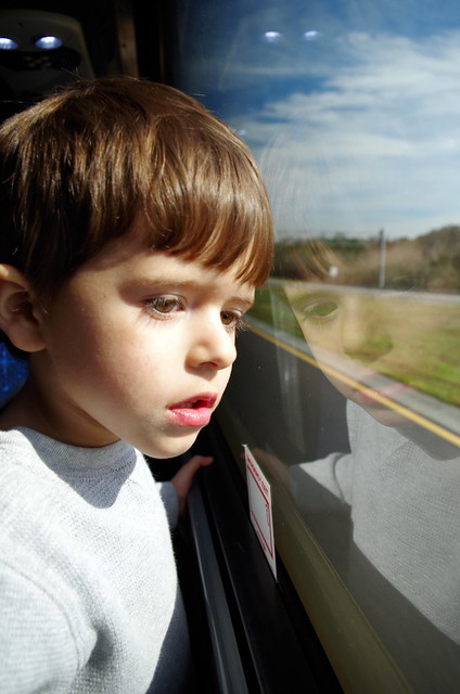 Carter looking out of the bus window