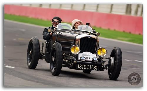 Panning shot of a Bugatti vintage sports car!