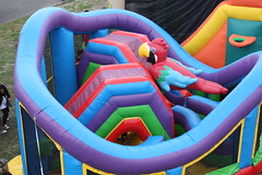 playhouse(0.0), swimming pool(0.0), water park(0.0), outdoor play equipment(1.0), play(1.0), recreation(1.0), leisure(1.0), games(1.0), playground slide(1.0), inflatable(1.0), playground(1.0),