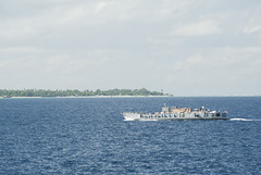 A landing craft utility from USS Pearl Harbor (LSD 52) with non-governmental organization (NGO) volunteers, partner nation military and U.S. service members aboard transits towards Tarawa, July 15 to begin work ashore during Pacific Partnership. (U.S. Navy photo by Mass Communication Specialist 2nd Class Tim D. Godbee)