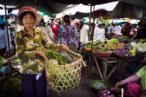 Client farmer selling her produce at the local market