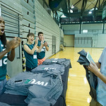 13-010 -- Titan Orientation Leaders Jordan Collins '15, Colleen Gleason '15 and Jake Colliander '15 pass out T-shirts and welcome new student Kenny Tran '17 with applause.