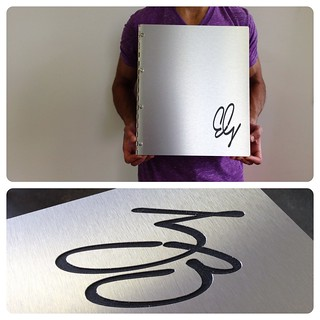 Custom brushed silver aluminum portfolio book with engraving treatment