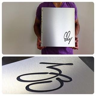 Custom brushed silver aluminum portfolio book with engraving treatment