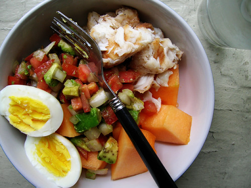 hardboiled egg, leftover tilapia and tomato, avocado, and sweet onion salsa from fish tacos, and cantaloupe