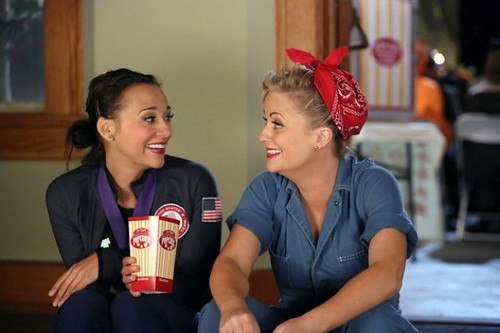 Leslie Knope dressed as Rosie the Riveter with Ann dressed as an Olympic gymnast for Halloween.