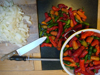 Making hot sause with the last of peppers.