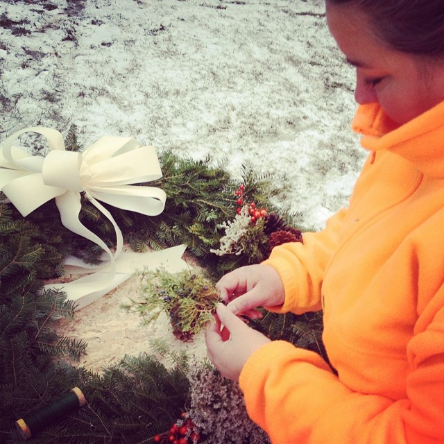 I spent this afternoon decorating the wreaths for the farmhouse. (Photo by Alex.)