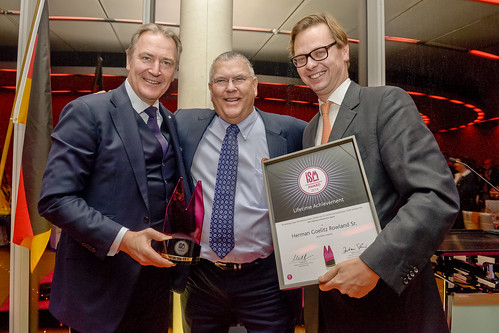 Mr. Rowland receives the first ISM Lifetime Achievement Award. (from left to right): Gerald Böse, CEO Koelnmesse GmbH; Herman Goelitz Rowland Sr., Chairman of the Board, Jelly Belly Candy Company, Bastian Fassin, Chairman of the International Confectionery Fair Taskforce (ASIM)