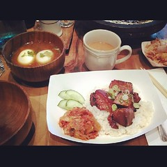 Order slow cooked eggs at Namu Gaji and it comes in a beautiful dashi broth along with tender meat of your choice (pork belly here) on a hot bed of rice. Little house Kim chee and fresh cucumber on side. by noelleonflickr