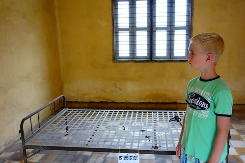 Watching images in torture room Tuol Sleng