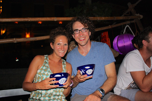 Drinking beer from huge bowls for 10,000 dong! Oh... on a boat, listening to live music. Love Hoi An