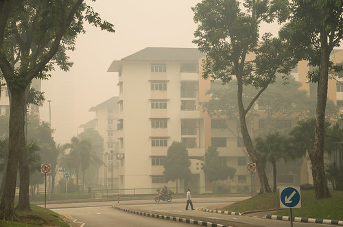 A man crossing the road in the smog near Bukit Merah Central - PSI has climbed to 400, an all time high.
