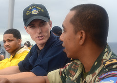 Quartermaster 3rd Class Nickolas Gibson discusses bridge operations with East Timor Navy Ensign Zito dos Belo as USS Blue Ridge (LCC 19) arrives off the coast of Dili, June 24. (U.S. Navy photo by Mass Communication Specialist 3rd Kelby Sanders)