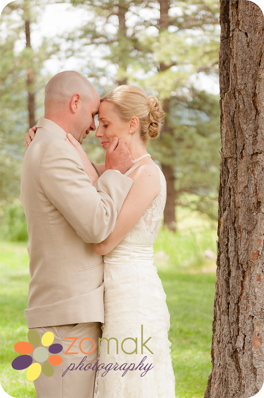 Bride and Groom embrace moments after their first look at the Double Arrow Resort in Seeley Lake, MT