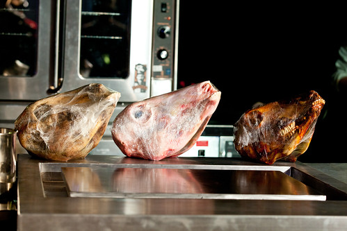 Row of veal heads from raw to roasted for Chef Michael Toscano of Perla's workshop