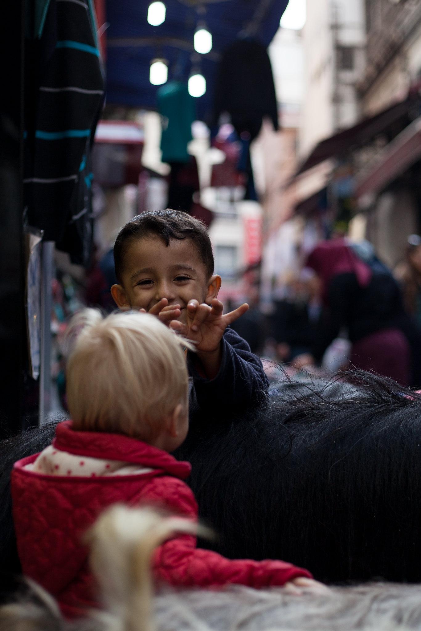 Boy talking to Neve over a stuffed goat, Eminönü.
