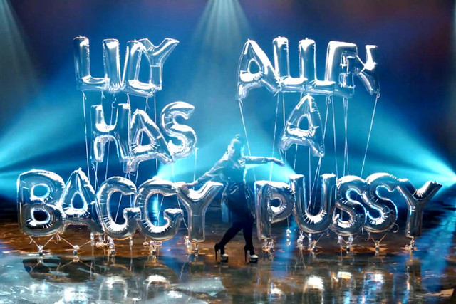 "A still from Lily Allen's video has giant balloons spelling out the phrase ""lily allen has a baggy pussy"""