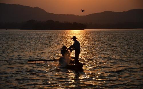 china sunset lake fishermen westlake hangzhou zhejiang