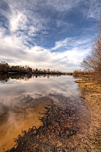 blue winter light sky brown white reflection tree nature wet weather clouds rural river season landscape outside outdoors countryside canal view empty scenic scene ukraine retro environment picturesque barren deserted oseschyna kyivskaoblast oseshchyna