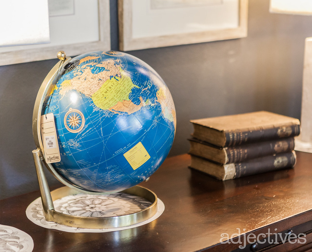 Desk globe and books at Adjectives Winter Park