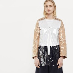 This is a jacket made out of clear pvc and brown paper. BROWN PAPER. It's Comme des Garçons and costs $590. I'm sorry but fashion is fucking petty.